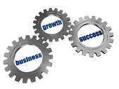 Business, growth and success in silver grey gearwheels — Stock Photo