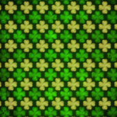 Striped shamrocks in green old paper background out of focus — Stock Photo
