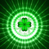 Green shamrock in circles with rays — Stock Photo