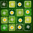 White flowers in squares over green old paper background — Stock Photo