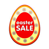 Easter sale in red egg shape label with flowers — Stock Photo