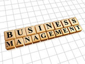 Business management in golden cubes — Stock Photo