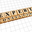 Expert consulting in golden cubes - Stock Photo