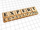 Expert consulting in golden cubes — Stock Photo