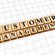 Customer management in golden cubes — Stock Photo