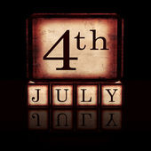 4th of July in wooden cubes over black — Stock Photo