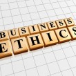 Stock Photo: Business ethics in golden cubes