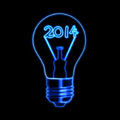 Glowing new year 2014 in bulb — Stock Photo