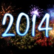Stock Photo: Neon new year 2014 with fireworks