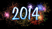 Neon new year 2014 with fireworks — Stock Photo