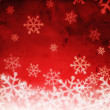 Photo: Abstract red background with snowflakes