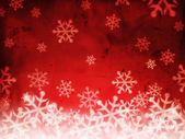 Abstract red background with snowflakes — Stock Photo