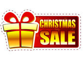 Christmas sale and gift box on red banner with snowflakes — Stock Photo