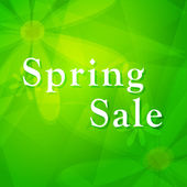 Spring sale over green background with flowers — Stockfoto