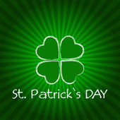 St. Patrick's Day with green shamrock and rays — Stock Photo