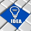 Idea and light bulb sign in boxes — Stock Photo