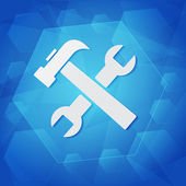 Tools sign over blue background — Stock Photo