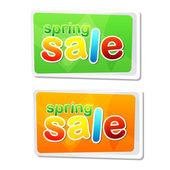 Spring sale in two flat design labels — Photo