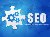 SEO with puzzle and world map, search engine optimization, flat — Stock Photo