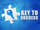 Key to success and puzzle piece with key sign, flat design — Stock Photo