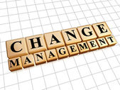 Change management in golden cubes — Stock Photo