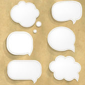 Cardboard Structure With White Paper Speech Bubbles — Stockvektor