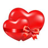 Dvě červené srdce s červenou stuhu — Stock vektor