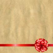 Bandera de papel retro con moño rojo — Vector de stock