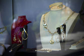Counter with variety jewelry in store window — Stock Photo