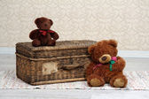 Old basket and two teddy bears — Stock Photo