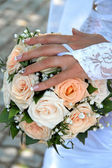 Bridal bouquet of flowers in hands of the bride — Stock Photo