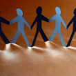 Group of paper people holding hands. Teamwork concept — Stock Photo #30404067