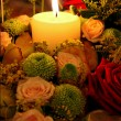 Candle and flowers — Stock Photo #33565823