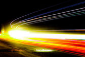 Car light trails. Art image . Long exposure photo taken in a tun — Stock Photo