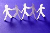 Group of paper people holding hands. Teamwork concept — Stock Photo