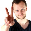 Stock Photo: Guy making peace sign