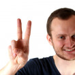 Stock Photo: Guy making a peace sign