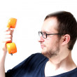 Guy holding an old telephone receiver — Stock Photo
