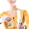 Girl holding a energy-saving lamp and a light bulb — Stock Photo #13657512