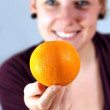 Girl balancing an orange — Stock Photo