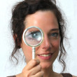 Royalty-Free Stock Photo: Young woman with magnifier