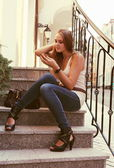 Young Woman Applying MakeUp Outdoors — Stock Photo