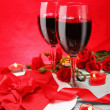 Romantic Candlelight Dinner for Two in Red - Stock Photo
