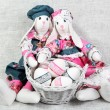 Two Easter Handmade Bunnies with Decorated Eggs - Stock Photo
