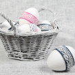 Basket with Easter Eggs and One Egg Close - Stock Photo