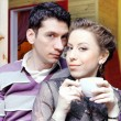 Young Lovers Couple in Cafe - Stock Photo