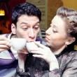 Young Lovers Drinking Coffee Funny Shot - Stock Photo
