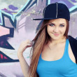 Smiling Teenager Girl Posing near Wall - Stock Photo