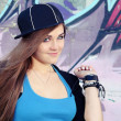Playful Teenager Girl Posing near Wall - Stock Photo