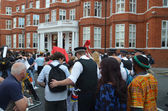 Police and protesters outside the Julian Assange protest outside The Ecuadorian Embassy — Stock Photo